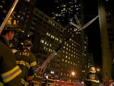 Crane strikes 25 story building downtown downtown new for 111 maiden lane salon
