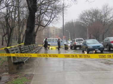 Police examine the body of an MTA worker found dead near his Inwood home on March 30, 2010.