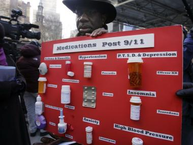 Sept. 11 first responder Marvin Bethea, at a 2007 press conference, displayed the medications he took following recovery work at the World Trade Center.
