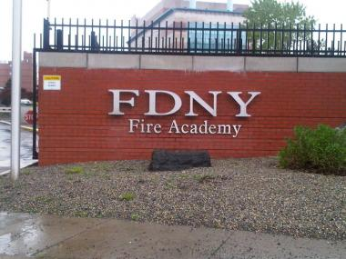 A firefighter fell off of a ladder at the FDNY Fire Academy on Randall's Island on Tuesday.