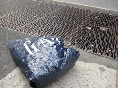 Although the GAP store on West 57th Street provided a bin where residents could recycle their old plastic bags, a discarded GAP bag floated along the sidewalk outside Wednesday afternoon.