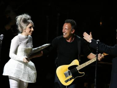 Lady Gaga and Sir Elton John, right, greet Bruce Springsteen after his performance during the Rainforest Fund's 21st Birthday Celebration benefit concert at Carnegie Hall Thursday, May 13, 2010 in New York.