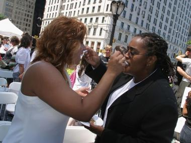 Elizabeth Medina-Turner (l.) and her partner Sharon Antonia Turner feed each other cake following a Wedding Party ceremony to kick off the Gay Pride march in New York City.