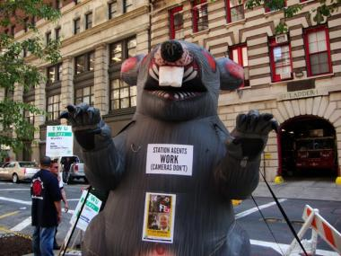 The transit worker's union TWU Local 100 places an inflatable rat in front of MTA Chairman Jay Walder's apartment building at 105 Duane Street on Wednesday, May 26, 2010.