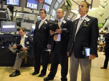 Traders gather on the floor of the New York Stock Exchange during the last day stocks plummeted, May 6, 2010.