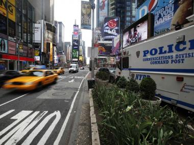 A police vehicle is seen in Times Square in New York, Sunday, May 2, 2010. Authorities say police have found an