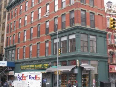This 1889 Queen Anne style building at 158-164 Lafayette Street is now protected by the SoHo-Cast Iron Historic District.