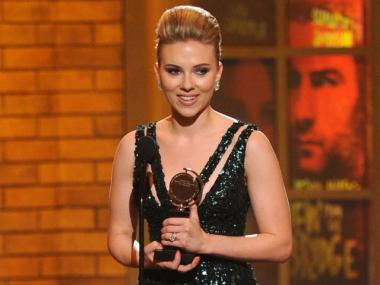 Actress Scarlett Johansson accepts her award for Best Performance by a Featured Actress in a Play onstage during the 64th Annual Tony Awards.