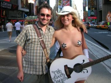 Louisa Holmlund, 27,  also performs in Times Square as the naked cowgirl, a privilege for which she reportedly pays a franchise fee.