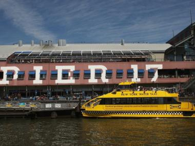 A water taxi pulls away from the Pier 17 mall at South Street Seaport on April 16, 2009.