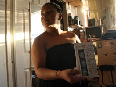 Erika Lorenzo, 34, holds up a picture of her son who was hit by an MTA tow truck in East Harlem.