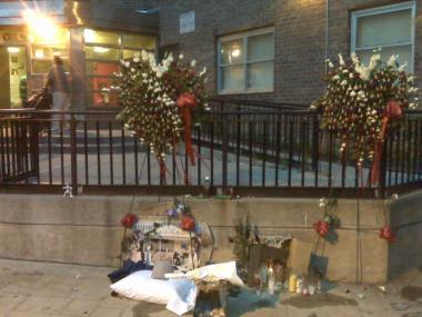 A shrine to Dereck Nelson outside the building where he grew up in East Harlem's Lincoln Houses.