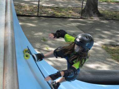 Max Schoenblatt, 11, of Miami, tries out the half-pipe at Riverside Park's skate park.