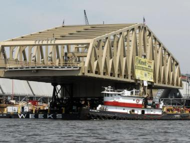 A newly-constructed swing bridge is loaded atop a pair of barges in the Hudson River in Coeymans, N.Y., Monday, July 12, 2010.