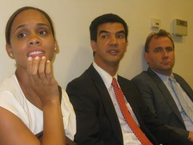 Rodriguez, with his wife and attorney, listens as the Ethics Committee announces its recommendation.