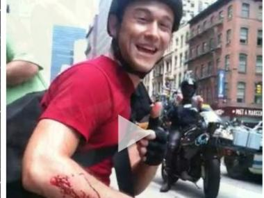 Joseph Gordon-Levitt gives a thumbs up to the camera after crashing into the back of a yellow cab.