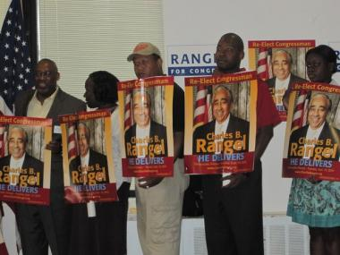 Rangel is surrounded by supporters at a press conference in Harlem