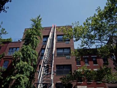 A ladder truck responds to a fire at West 83rd Street.