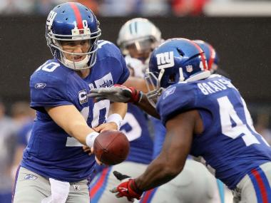 Eli Manning hands off the ball to running back Ahmad Bradshaw during the team's season opener against the Carolina Panthers.