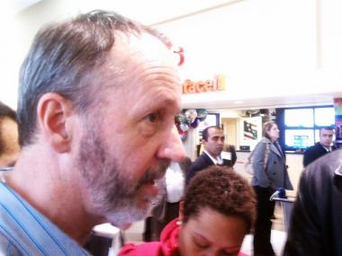 Louis Kelley spoke to reporters after leaving Emirates Air Flight 201 at Kennedy Airport.