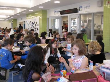 Students at P.S. 276 in their new cafeteria in the fall of 2010. All schools in the city that have extra money will lose 30 percent of it at the end of the fiscal year, under the Department of Education's new budget measure.