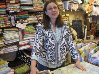 Down Quilt Shop owner Beth Scholten says small stores like hers are a dying breed. She said she didn't find out about Small Business Saturday until Saturday morning.