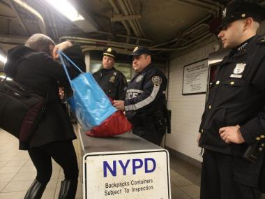 NYPD officers inspect bags inside the Union Square subway station during the morning commute March 29, 2010. The city heightened security on subways following the subway terrorist attacks in Moscow that killed at least 38 people.