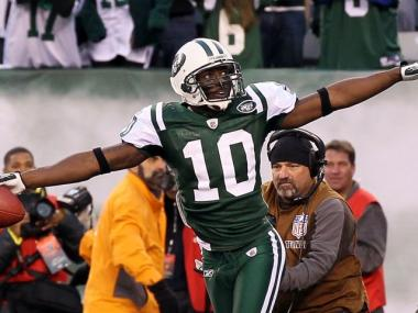 Santonio Holmes celebrates after his fourth quarter touchdown with 10 seconds left in the game gave New York a 30-27 victory over the Houston Texans on Nov. 21.