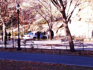 The body found in Marcus Garvey Park was covered in a white sheet as police investigated the scene Wednesday.