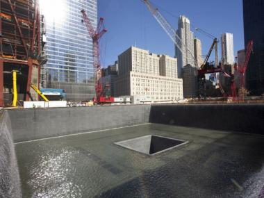 A test of the North Tower memorial pool in the fall of 2010. Millions of people are expected to visit the memorial after it opens in September 2011.