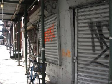 The grills on 502 Canal St. are tagged with graffiti.