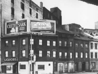 The three-story building at 502 Canal St. and its neighbors, shown in 1965.