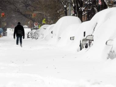 A man walks through the snow in Manhattan's East Village December 27, 2010 in New York City.