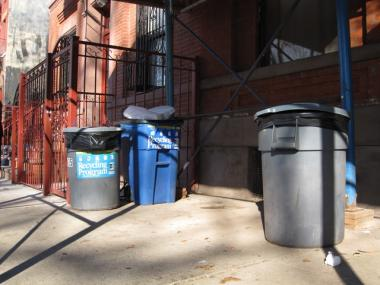 The body of Betty Williams was found stuffed in a suitcase, wedged between these garbage cans outside 435 East 114th Street.
