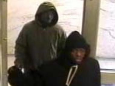 Police released images of the mugging suspects. They are described as men in their 20s, both about 5-foot 9-inches tall.