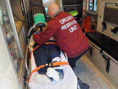 A specialist demonstrated how a donor would be handled inside the Organ Preservation Unit truck last month.