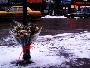 Flowers were left to memorialize Laurence Renard on a First Avenue sidewalk Tuesday.