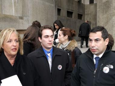Sylvie Cachay's brothers and lawyer exit court.