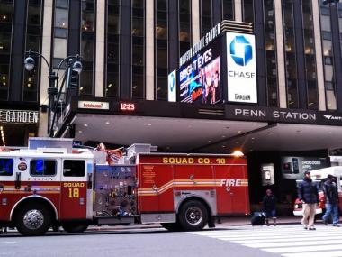 Fire trucks park outside 2 Penn Plaza, where office workers were treated for exposure to cleaning solution, officials said.