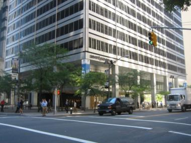 The city recently proposed a rezoning that would allow buildings like 77 Water St. to put public tables and chairs on their covered sidewalk.