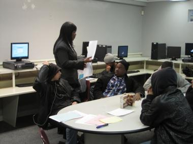 A teacher works with students in Union Settlement's job training and GED programs.
