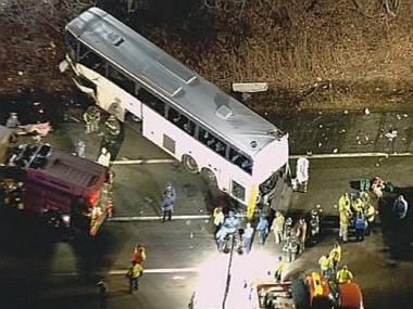 A Chinatown tour bus headed to Philadelphia crashed off the New Jersey turnpike Monday night, leaving two dead and dozens injured.