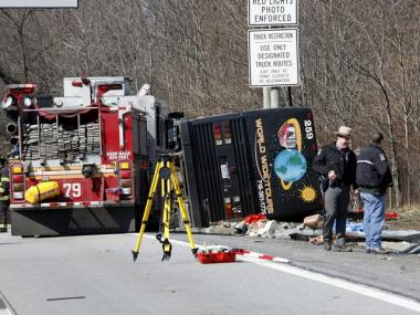 Investigators work to find the cause of a bus crash which killed at 15 in the Bronx on March 12, 2011.