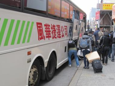 Passengers board a bus in Chinatown. Under proposed legislation that passed in the state Assembly, a permit system would be established to better regulate the low-cost tour bus industry.