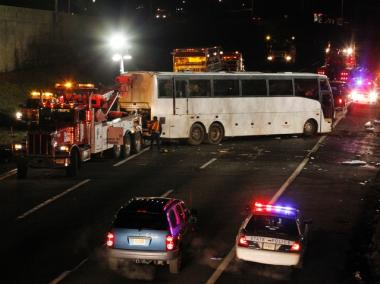 A luxury bus is attached to a tow truck on March 15, 2011, in East Brunswick, N.J. after its crash on the southbound New Jersey Turnpike, late Monday.