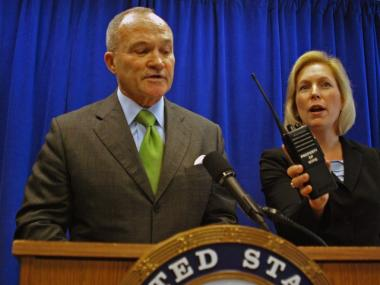 Senator Kirsten Gillibrand holds up a two-way radio during a press conference with Police Commissioner Ray Kelly on April 11, 2011. Gillibrand and Kelly want Congress to pass a bill allowing local and federal agencies to use a single public safety spectrum.