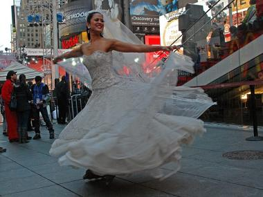 Marni Halasa celebrates in Times Square, complete with wedding dress and roller blades.