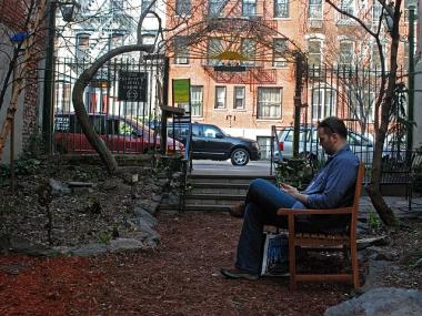 East Village resident Reid Thompson enjoys some downtime in The Creative Little Garden.