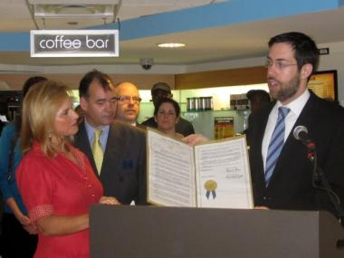 State Sen. Daniel Squadron presented J&R co-founder Rachelle Friedman with a state resolution commending the store.