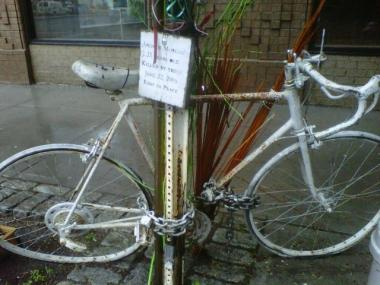 A ghost bike memorializes the death of Andrew Ross Morgan, a cyclist who was killed in 2005 at Houston and Elizabeth Street.